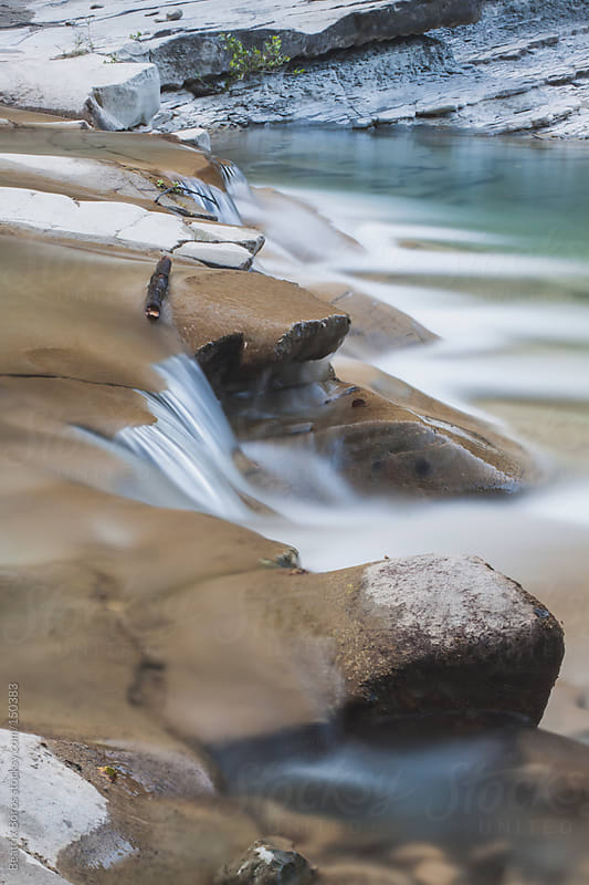 Mountain river in the Apennines in Italy with little waterfalls by Beatrix Boros for Stocksy United