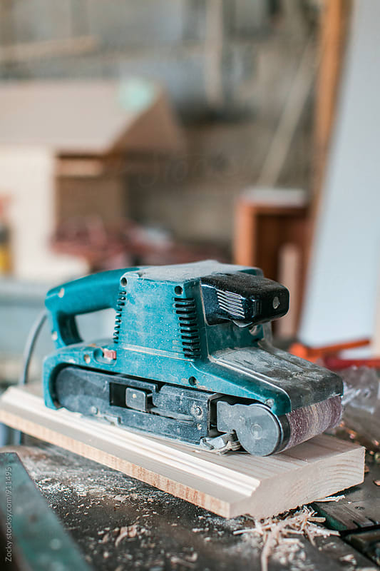 Belt sander in workshop by Zocky for Stocksy United