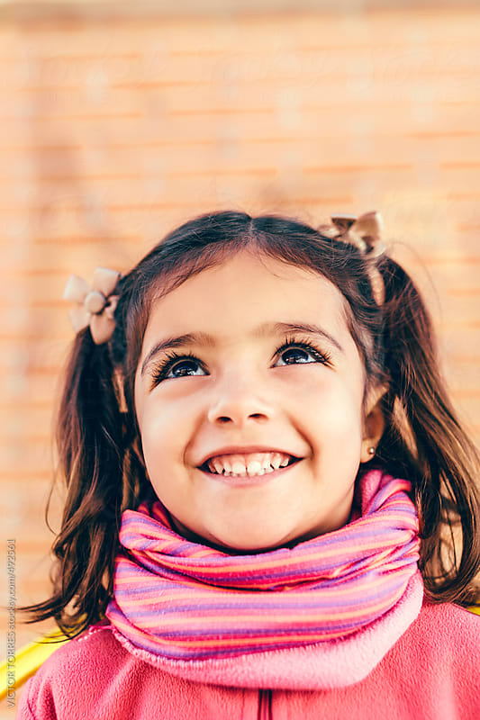 Portrait of a Cute Little Girl in the Playground by VICTOR TORRES for Stocksy United