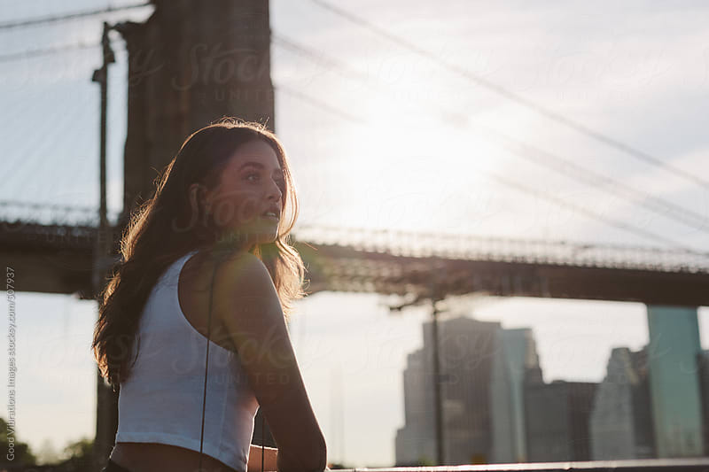 Brunette at the Brooklyn Bridge in NYC by Good Vibrations Images for Stocksy United