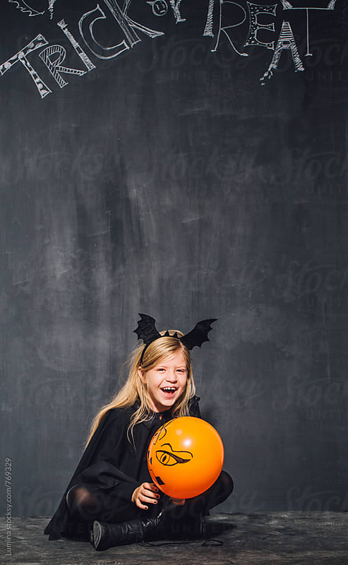 Blonde Girl Dressed as a Witch Laughing by Lumina for Stocksy United