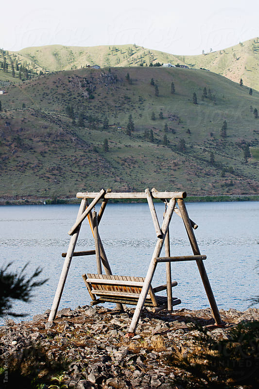 rustic bench on viewpoint over lake by Tana Teel for Stocksy United