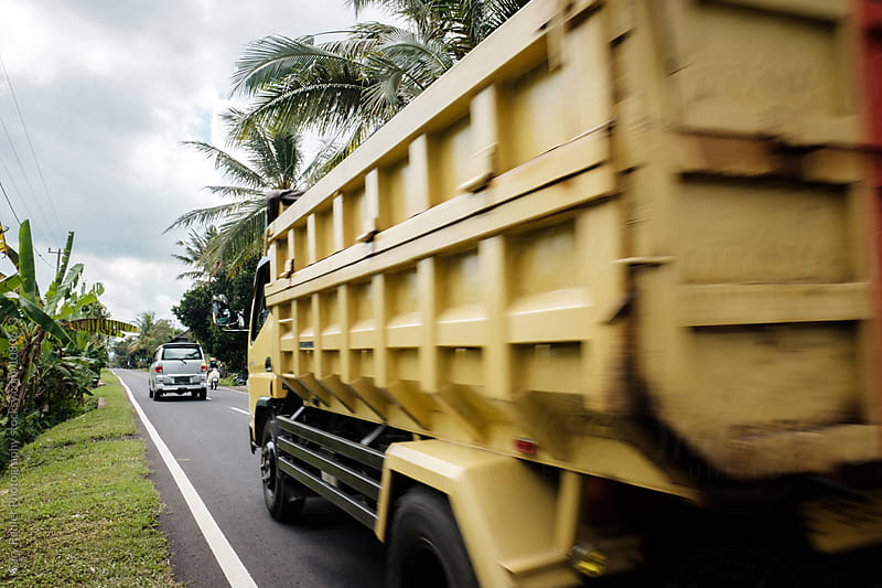 Truck Speeding Past on a Bali Road by Gary Radler Photography for Stocksy United