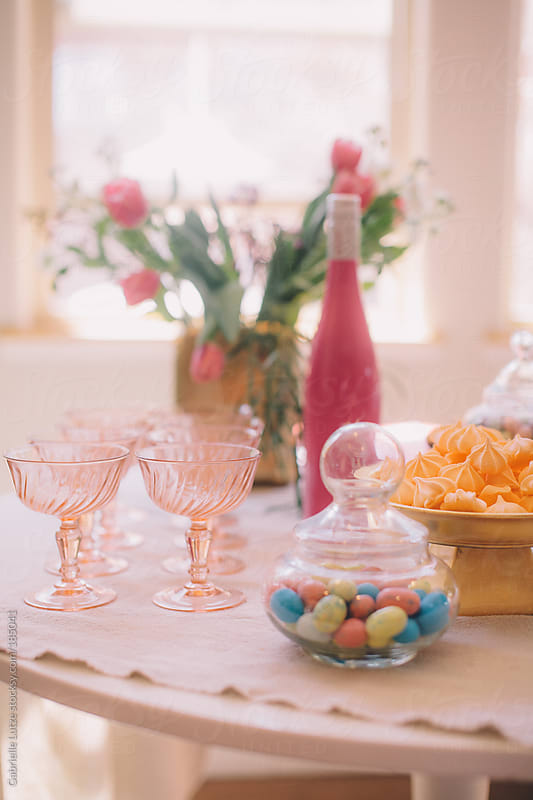 Pretty Party Treats and Champagne Table by Gabrielle Lutze for Stocksy United