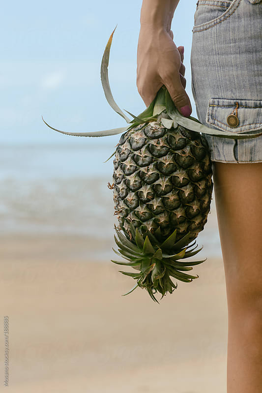 Anonymous Woman Holding Pineapple by Mosuno for Stocksy United
