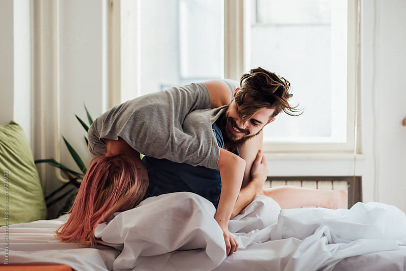 Pretty Couple Playing With Each Other in Bed by Nemanja Glumac for Stocksy United
