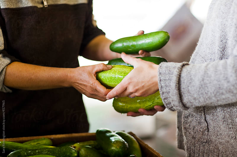 Sharing Zucchini At Farmer's Market by Sara Remington for Stocksy United