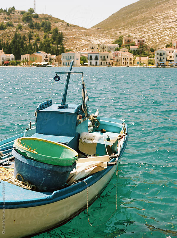 Boat in the harbour at Kastellorizo, Greece by Kirstin Mckee for Stocksy United