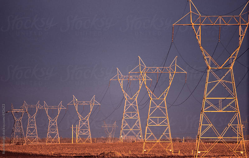 power lines powelines at sunset late afternoon on prairies of North Dakota by Ron Mellott for Stocksy United