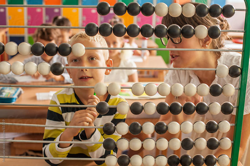 Schoolboy Using Abacus by Mosuno for Stocksy United
