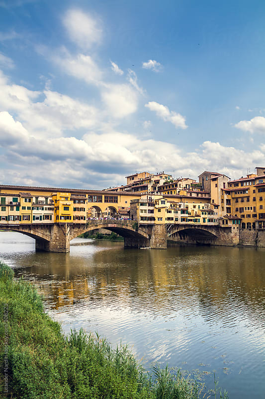 Ponte Vecchio over the river Arno by Leander Nardin for Stocksy United