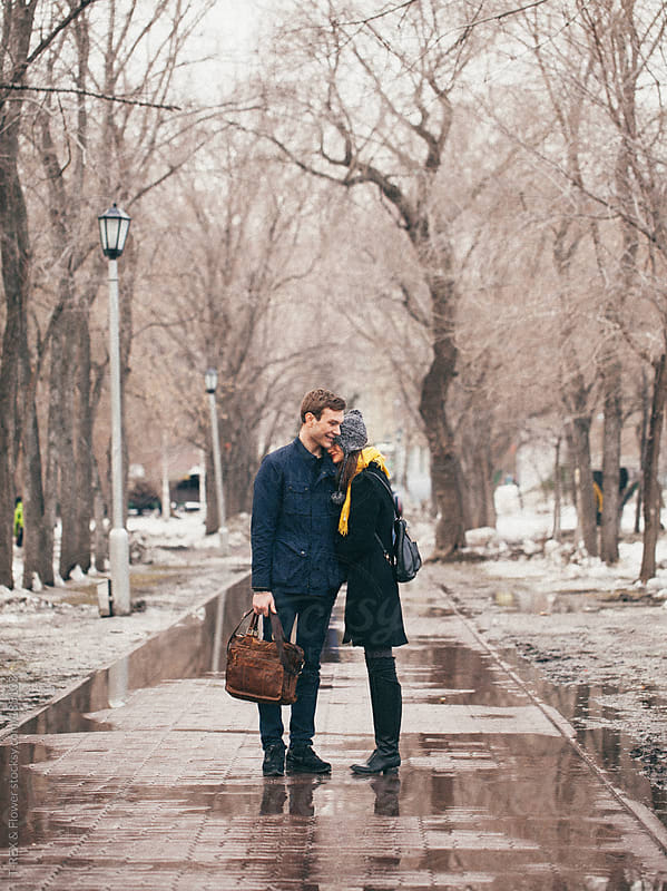 A couple embracing in the park by Danil Nevsky for Stocksy United