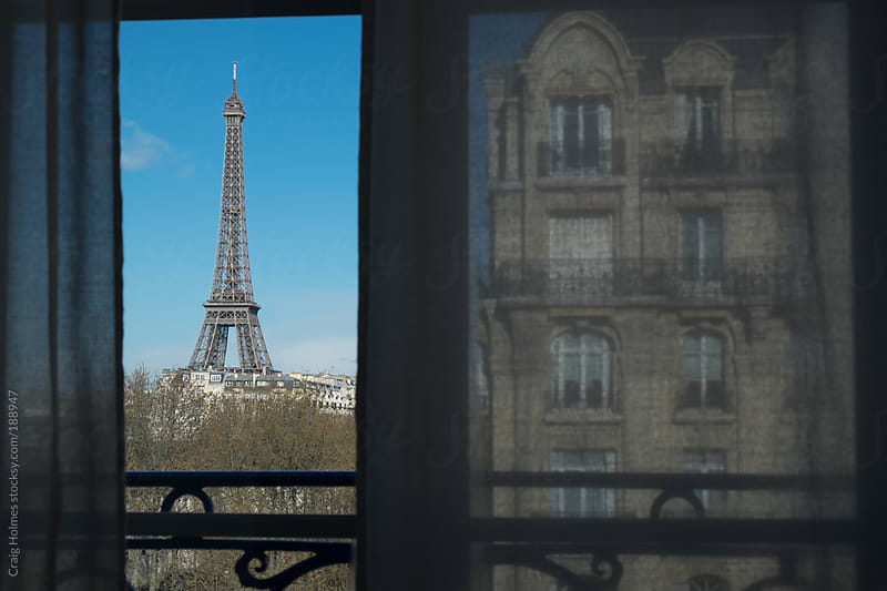 The Eiffel Tower, Paris, France, viewed through a window. by Craig Holmes for Stocksy United