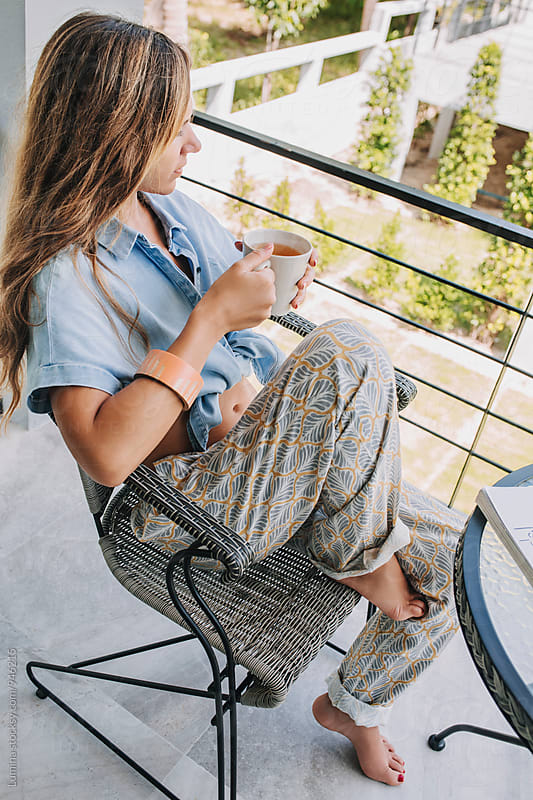 Woman Drinks Tea on the Balcony at Home by Lumina for Stocksy United