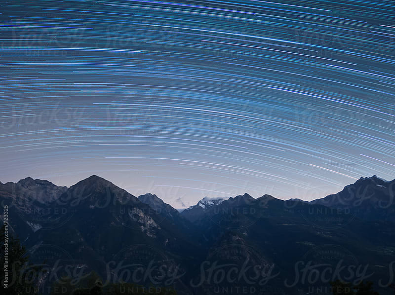 Mountains and star trails by Milena Milani for Stocksy United