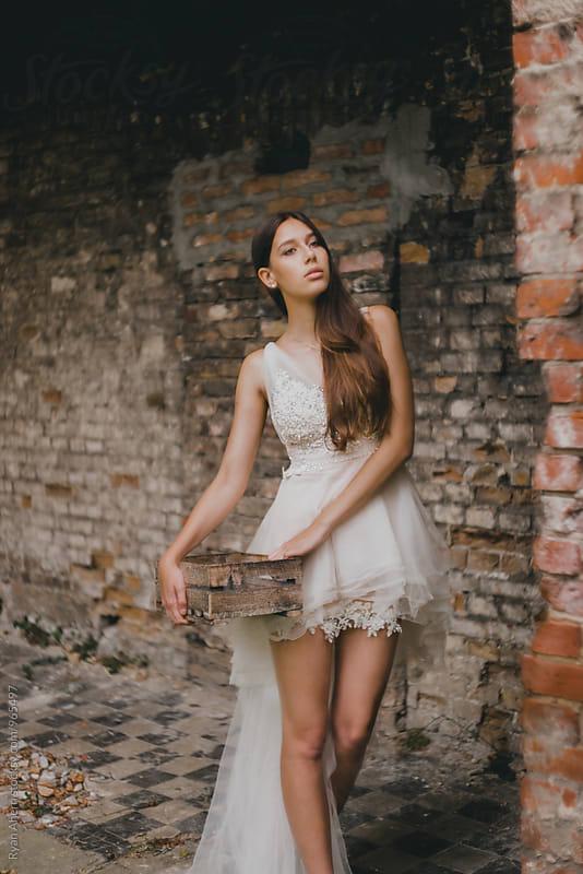 Girl in white designer dress  by Ryan Ahern for Stocksy United