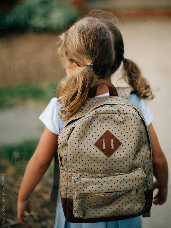 little girl in uniform on her first day of kindergarten by Meaghan Curry for Stocksy United