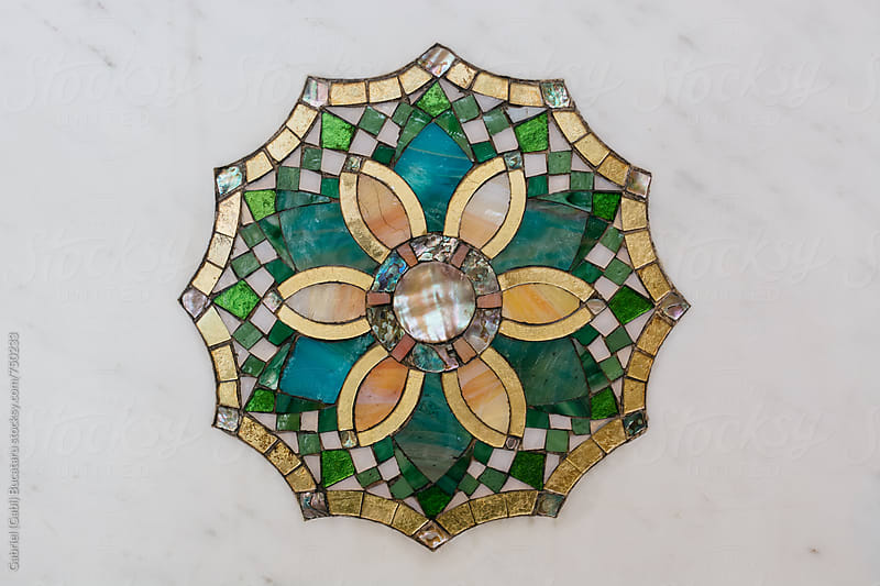 Floral mosaic decoration on a marble wall by Gabriel (Gabi) Bucataru for Stocksy United