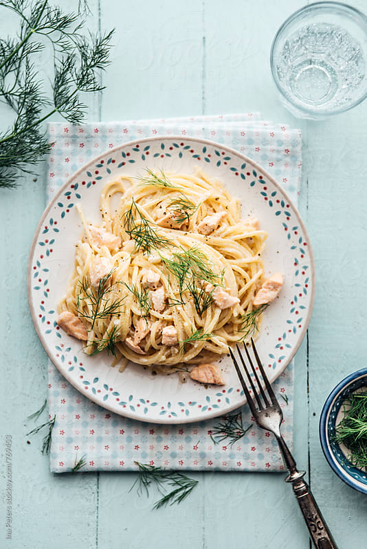 Food: Spaghetti with Salmon white wine cream sauce and dill by Ina Peters for Stocksy United