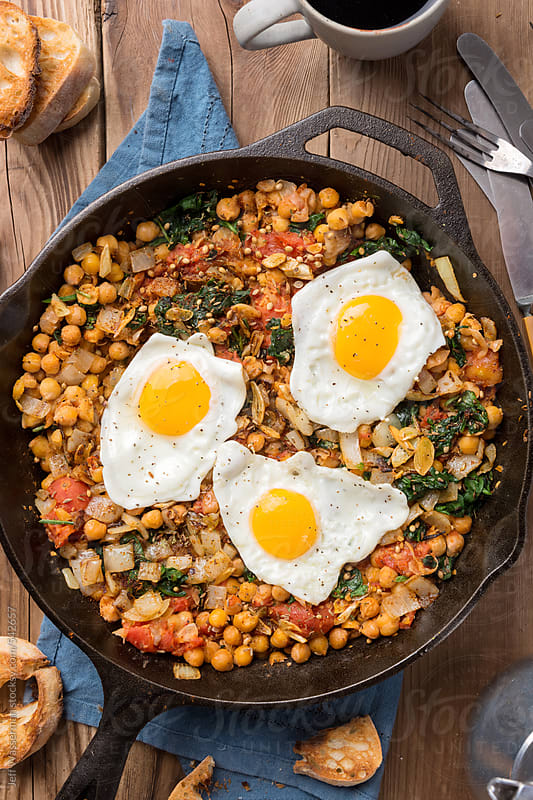 Spinach With Chickpeas And Fried Eggs by Studio Six for Stocksy United