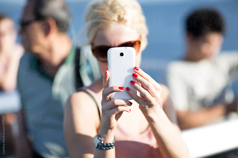 Woman Photographing With a Mobile Phone by Lumina for Stocksy United