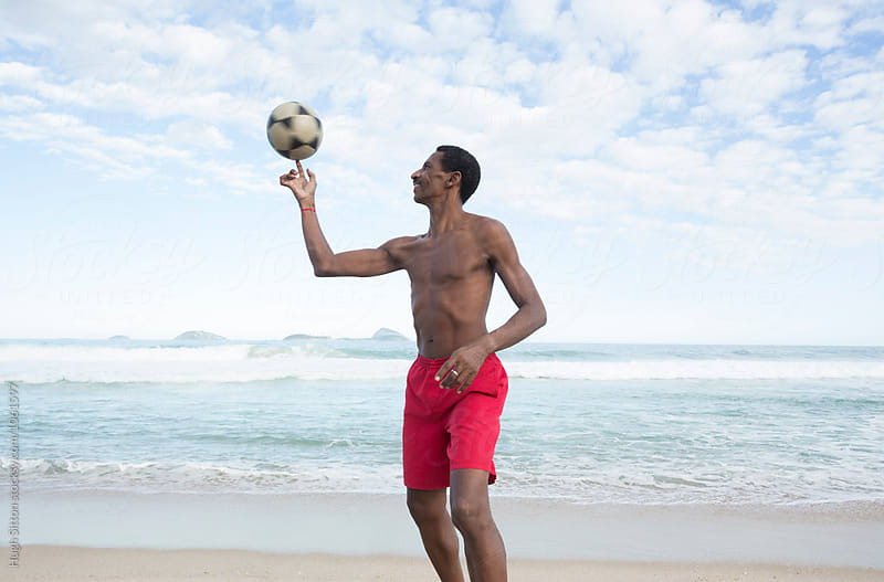 Brazilian man with soccer ball. Ipanema Beach. Rio de Janeiro. by Hugh Sitton for Stocksy United