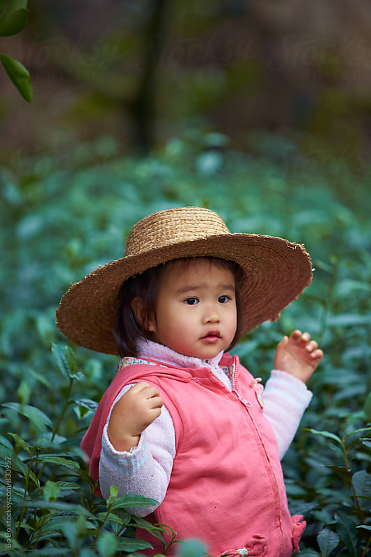close up of little girl wear hat outdoor by Bo Bo for Stocksy United