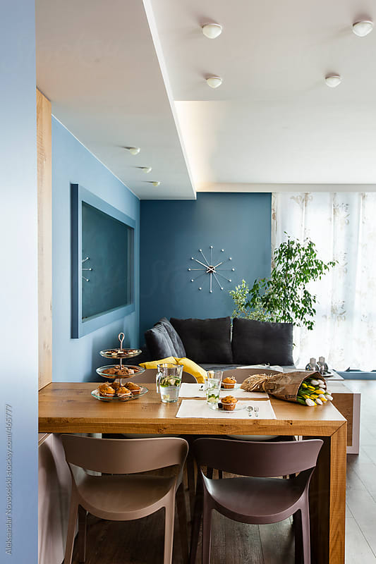 Contemporary interior - decorated living room in blue by Aleksandar Novoselski for Stocksy United
