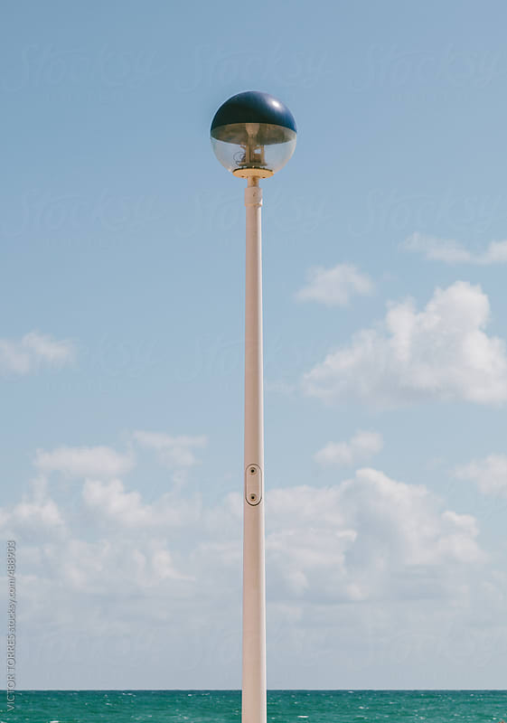 Street Lamp Besides the Sea by VICTOR TORRES for Stocksy United