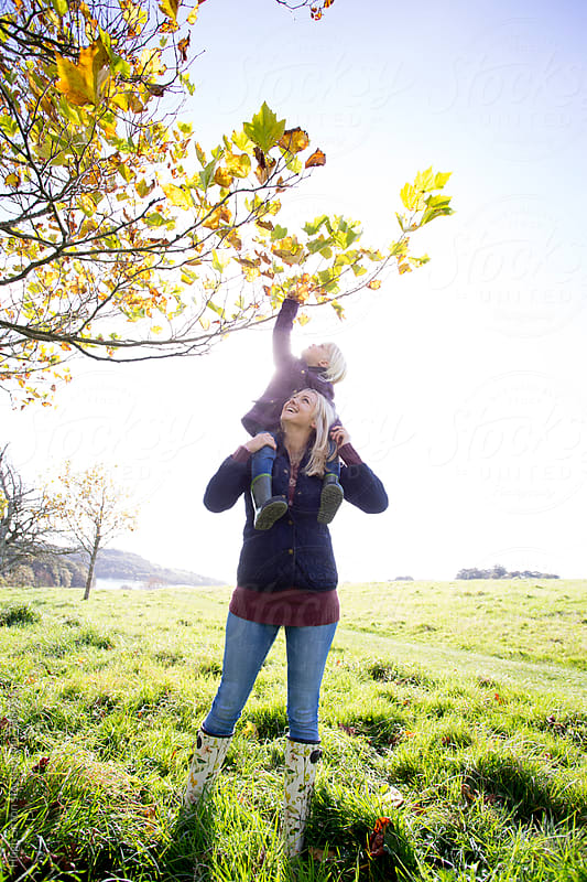 Mother and Daughter on autumn walk. by Hugh Sitton for Stocksy United