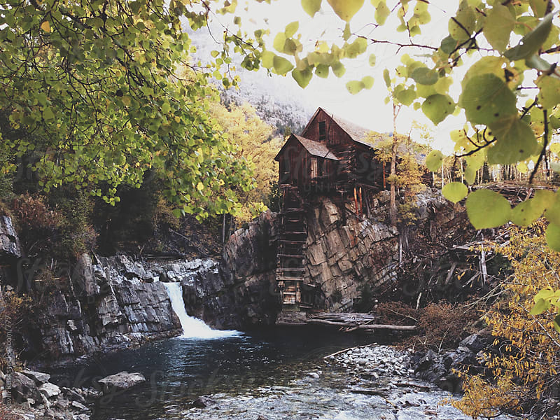 The Old Crystal Mill and Waterfall by Kevin Russ for Stocksy United