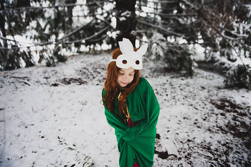 Young girl with an owl mask in the forest by Audrey Amaro for Stocksy United