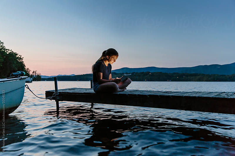 Teen Girl Using Tablet Lakeside by Raymond Forbes LLC for Stocksy United