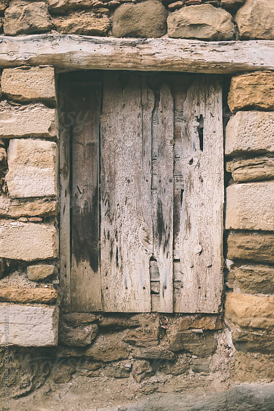 old wooden window in a rural town by Javier Pardina for Stocksy United