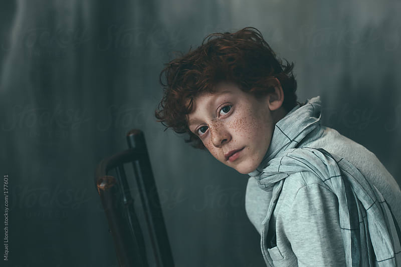 Portrait of a young boy by Miquel Llonch for Stocksy United