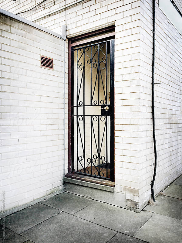 A secure doorway by James Ross for Stocksy United