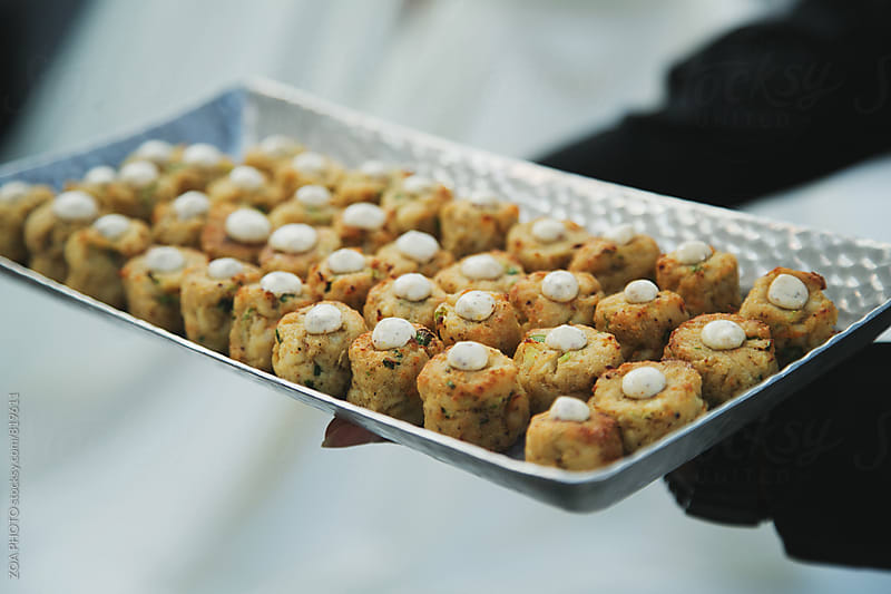 Crab cakes on a tray by ZOA PHOTO for Stocksy United
