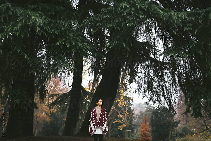 Stylish young black woman in the forest by Simone Becchetti for Stocksy United