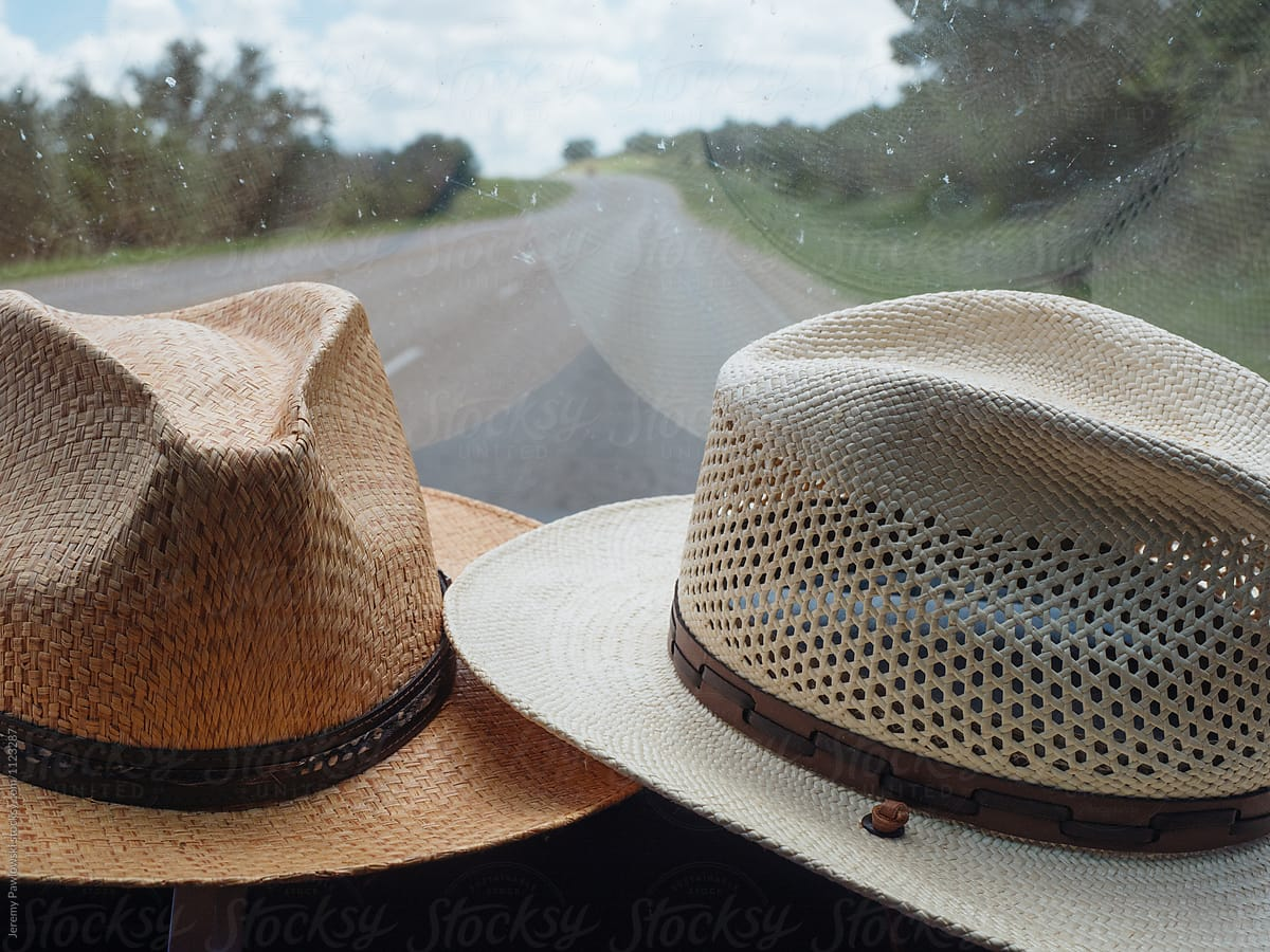 Straw hats belonging to married couple on dashboard of car by Jeremy  Pawlowski for Stocksy United 91a4e3886b4a
