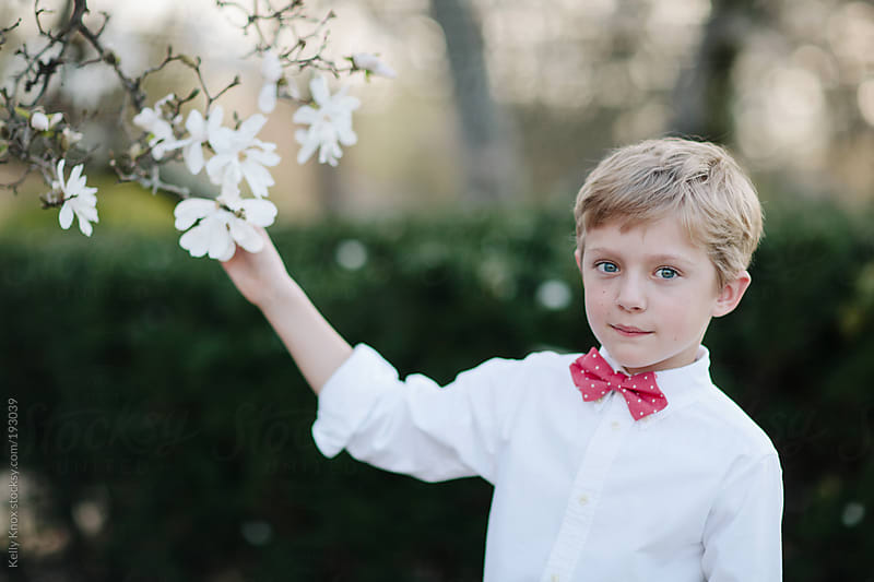 spring portrait of a young boy by Kelly Knox for Stocksy United