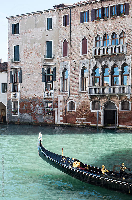 Gondola on a Venice's canal by Bisual Studio for Stocksy United
