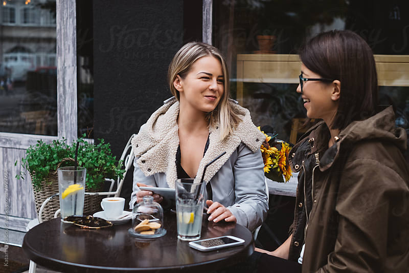 Two Female Friends Having Good Time While Drinking Coffee at Cafe by Katarina Radovic for Stocksy United