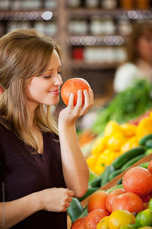 Market: Enjoying The Smell Of Fresh Grapefruit by Sean Locke for Stocksy United