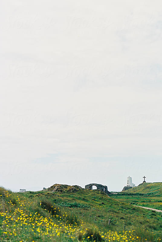 lighthouse and cross on island by Léa Jones for Stocksy United