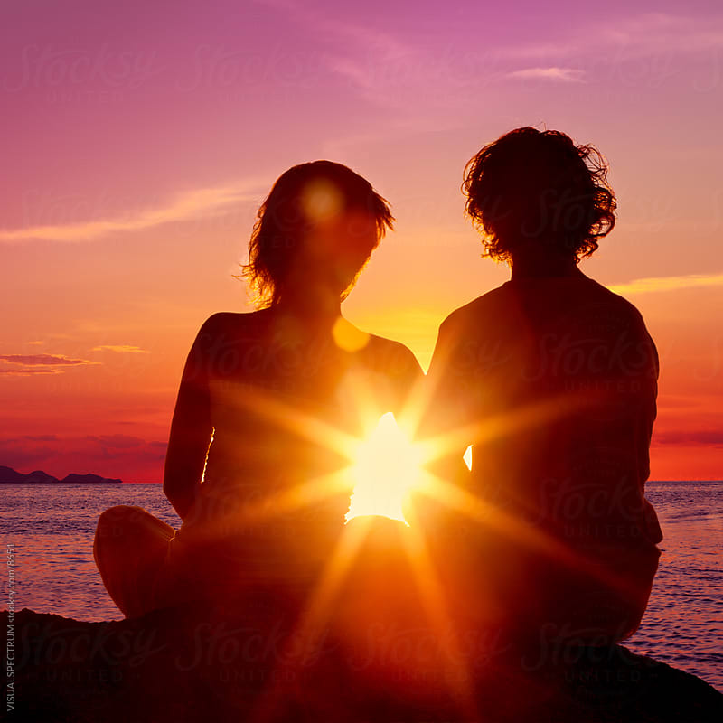 Lovers Watching a Romantic Sunset by VISUALSPECTRUM for Stocksy United
