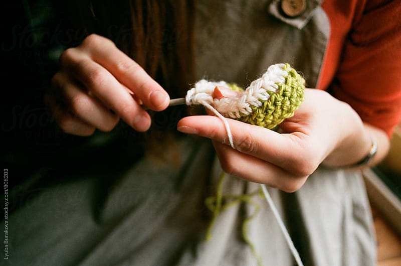 Close up shot of woman's hands knitting with a crochet by Lyuba Burakova for Stocksy United