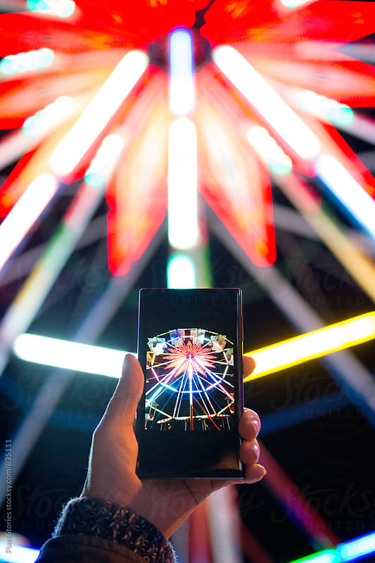 Taking picture of ferris wheel by Pixel Stories for Stocksy United