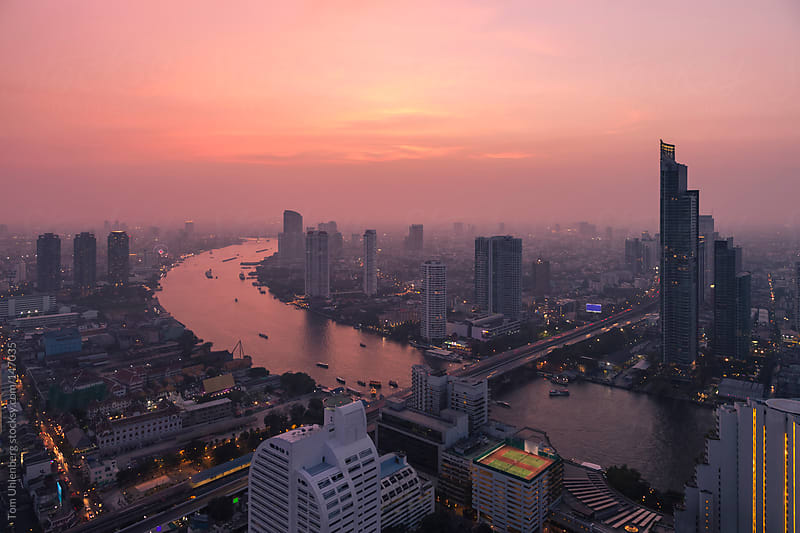 Evening Panorama of Bangkok, Thailand with the Chao Phraya River by Tom Uhlenberg for Stocksy United