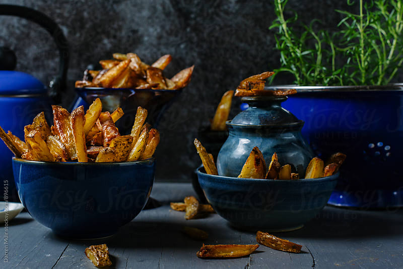Homemade fries. by Darren Muir for Stocksy United