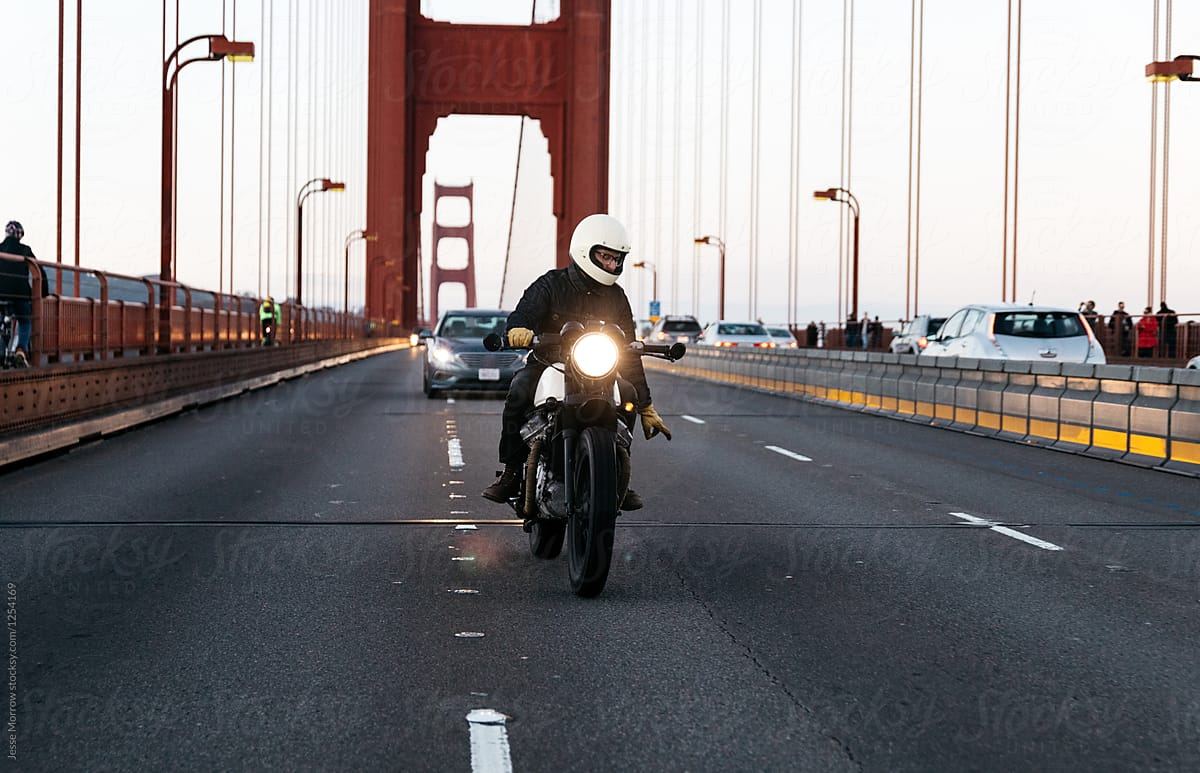 San Francisco Motorcycle >> Portrait Of Young Male Riding Motorcycle Across Golden Gate